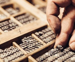 Artisan composing movable type for Letterpress Printing.